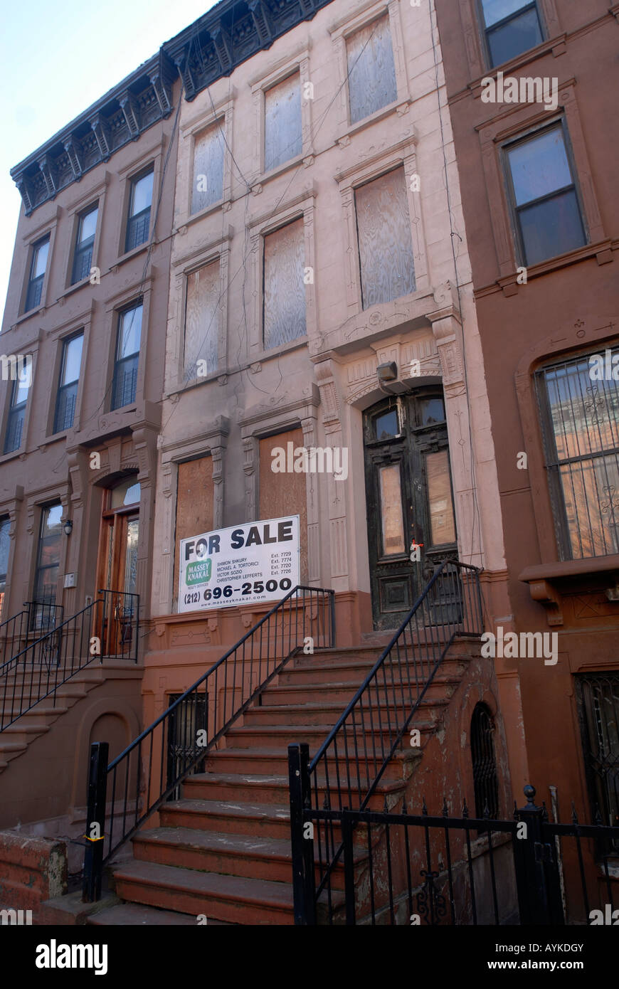 Vacant brownstone for sale in harlem in nyc stock photo for New york city brownstone for sale