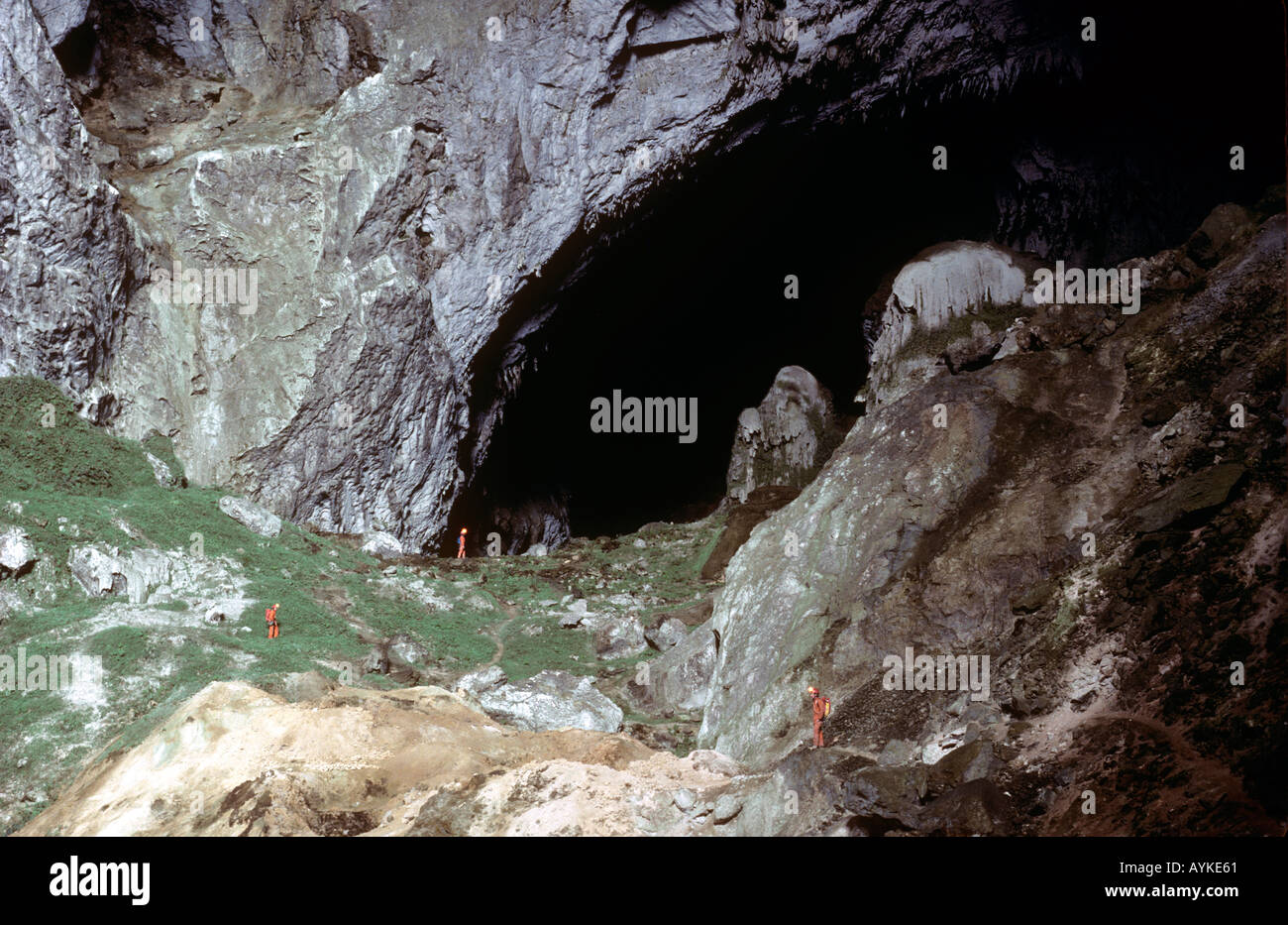 Cavers dwarfed by huge entrance passage of Ma Wang Dong cave ...