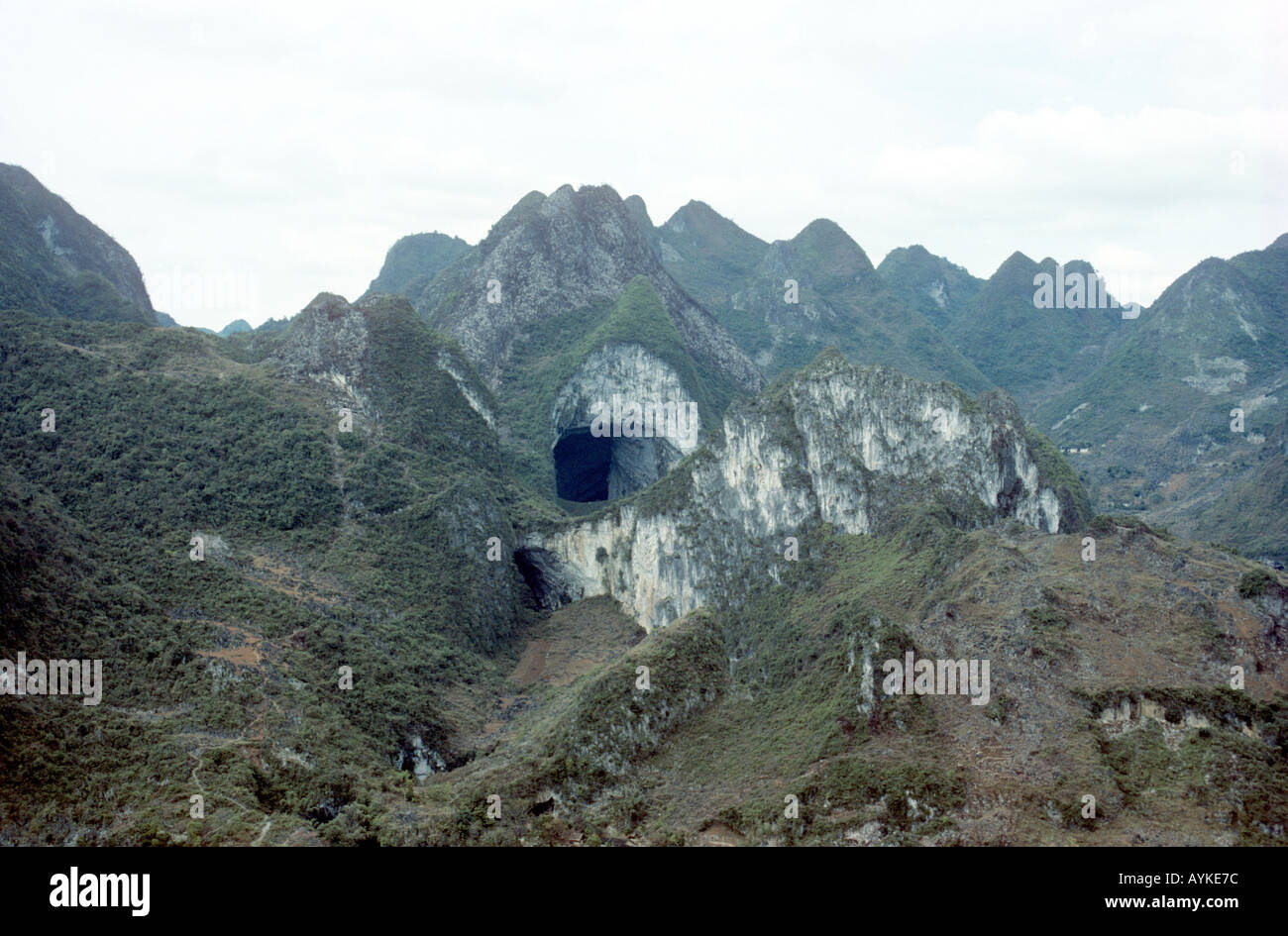 100m wide entrance to Ma Wang Dong cave system Guangxi China Stock ...