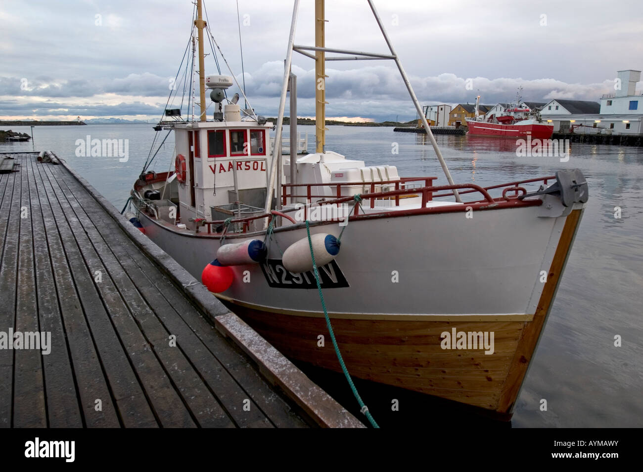 Fishing boat alongside old wooden quay at ballstad for Old fishing boat