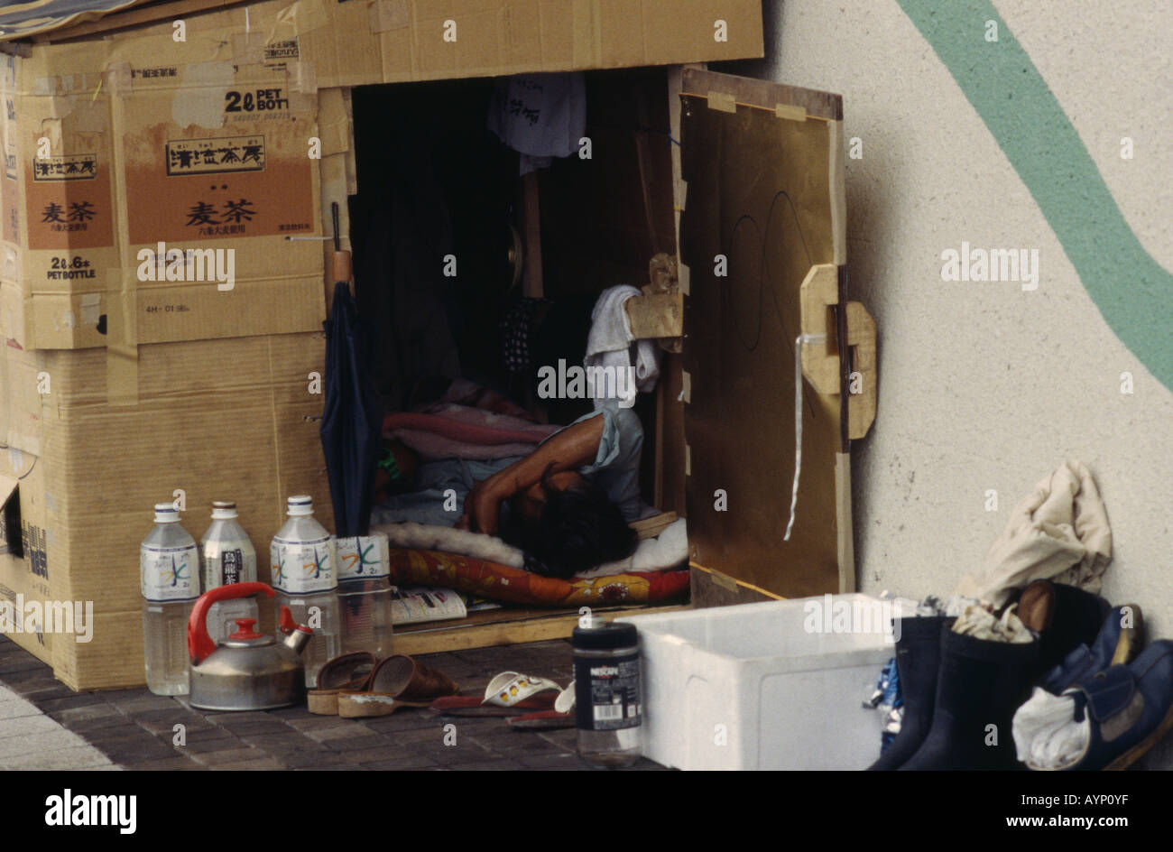 japan honshu tokyo homeless man living in a cardboard box shelter on stock photo royalty free. Black Bedroom Furniture Sets. Home Design Ideas