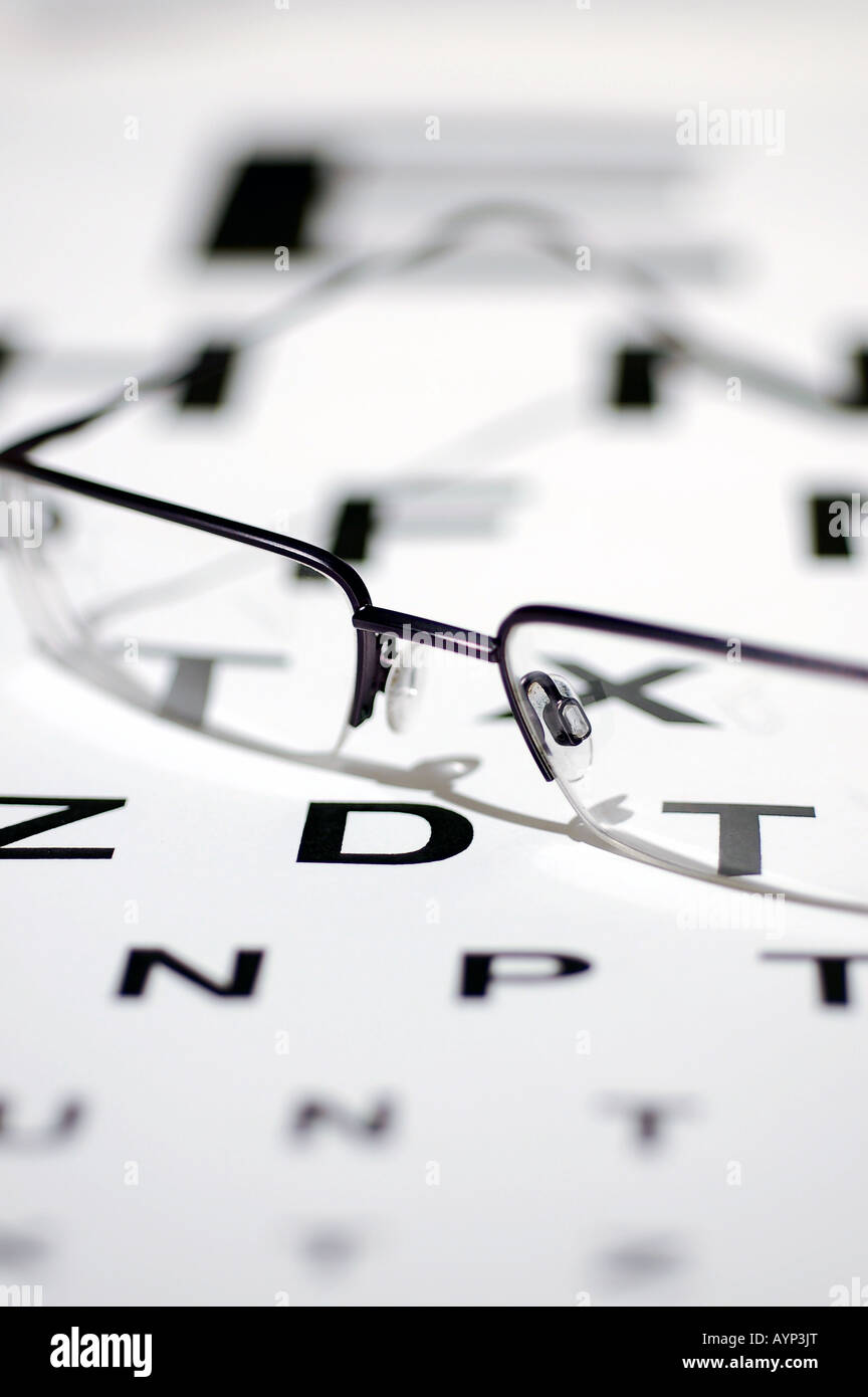 Pair of spectacles with a snellen eye chart stock photo royalty pair of spectacles with a snellen eye chart geenschuldenfo Choice Image