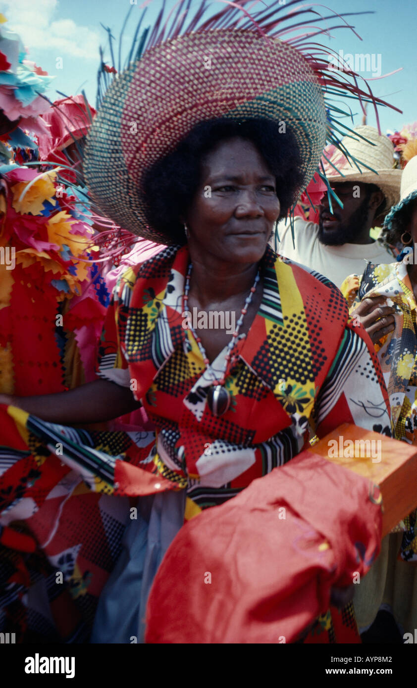 HAITI Caribbean West Indies People Religion Festivals Portrait Of Woman At Voodoo Ra Procession With Wide Brimmed Straw Hat
