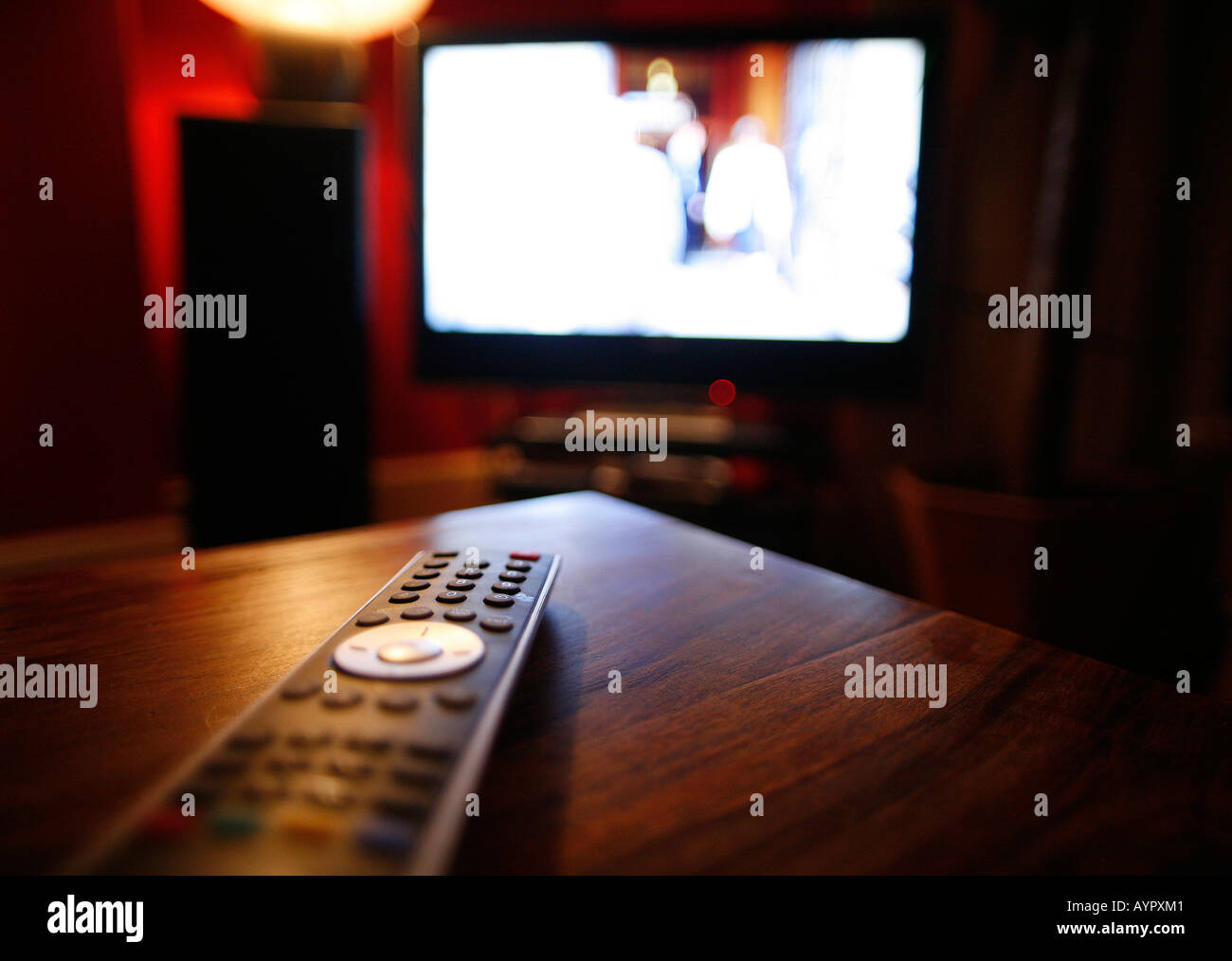 Tv remote control on a coffee table stock photo royalty free stock photo tv remote control on a coffee table geotapseo Gallery