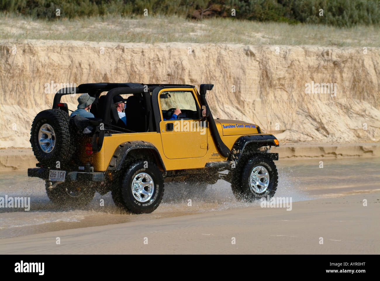 Suv Jeep Driving On The Beach At Fraser Island Queensland