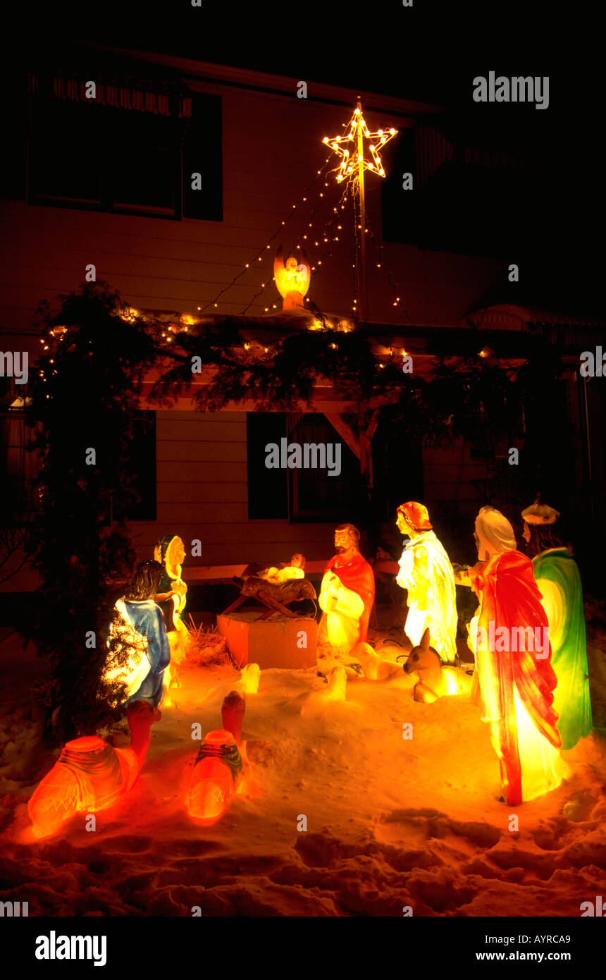 Lighted Outside Nativity Scene In The Snow Symbolizing The Birth Of Jesus.  Minneapolis Minnesota USA