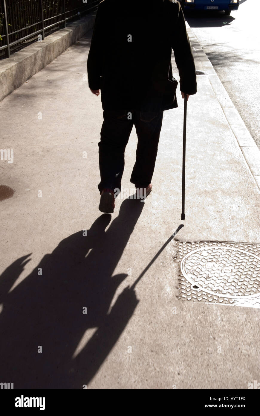 a cropped view of an old man walking away with walking ... Stick Man Walking Away