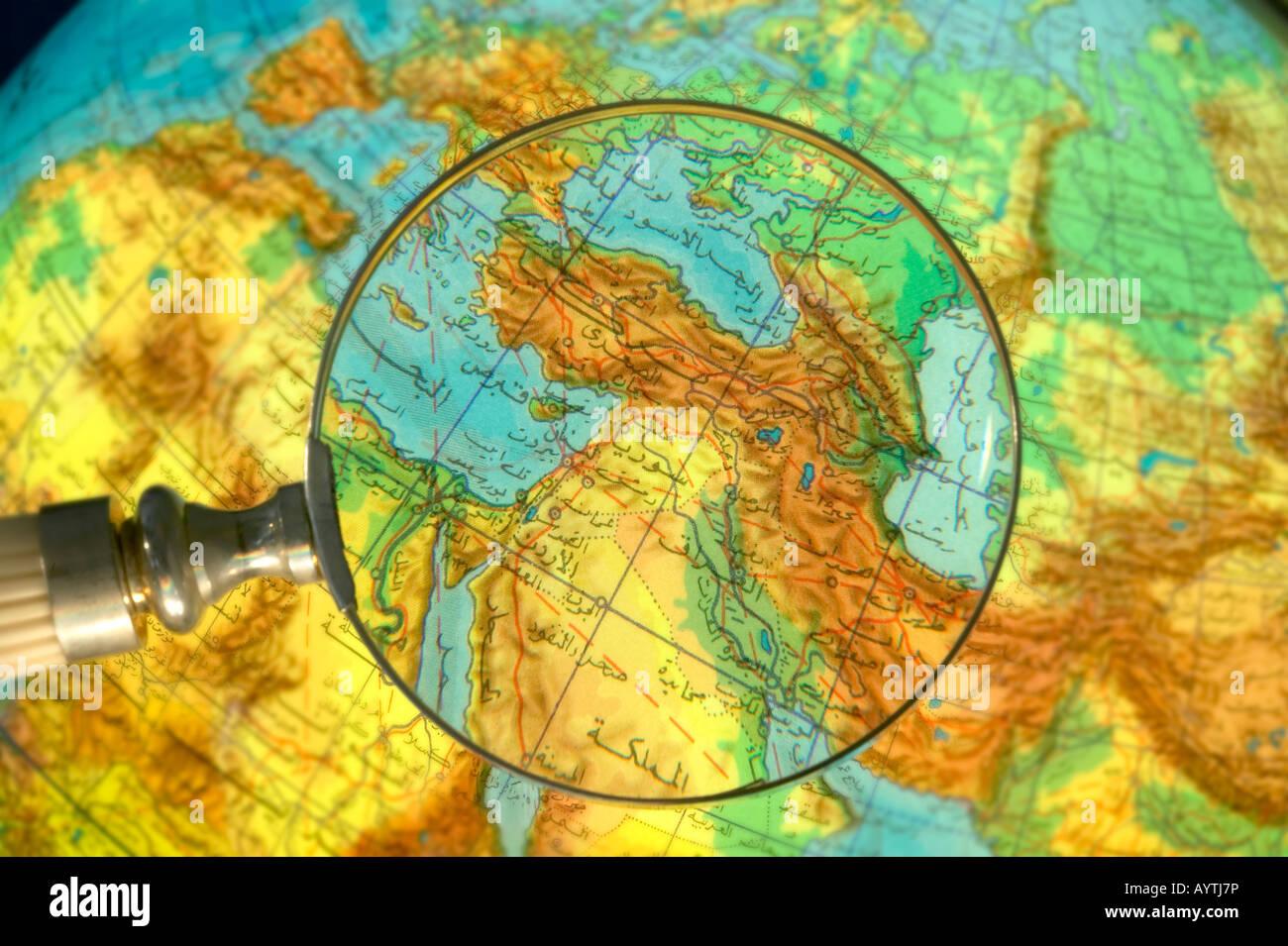 Part of world Middle East Region globe written in Arabic seen