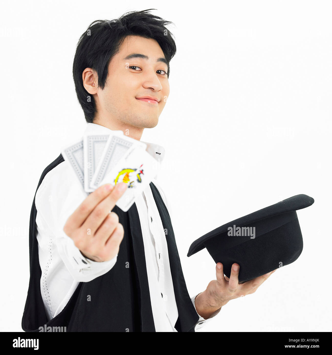 man holding black hat and card stock photo royalty image stock photo man holding black hat and card