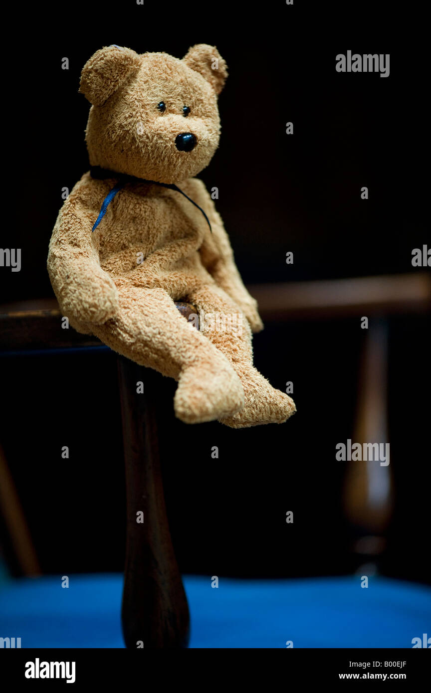 teddy bear sitting on antique wooden chair stock photo royalty free image 17221863 alamy. Black Bedroom Furniture Sets. Home Design Ideas