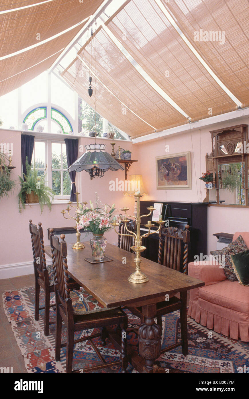 Split Cane Blinds In Conservatory Extension Dining Room With Oak Table And Chairs