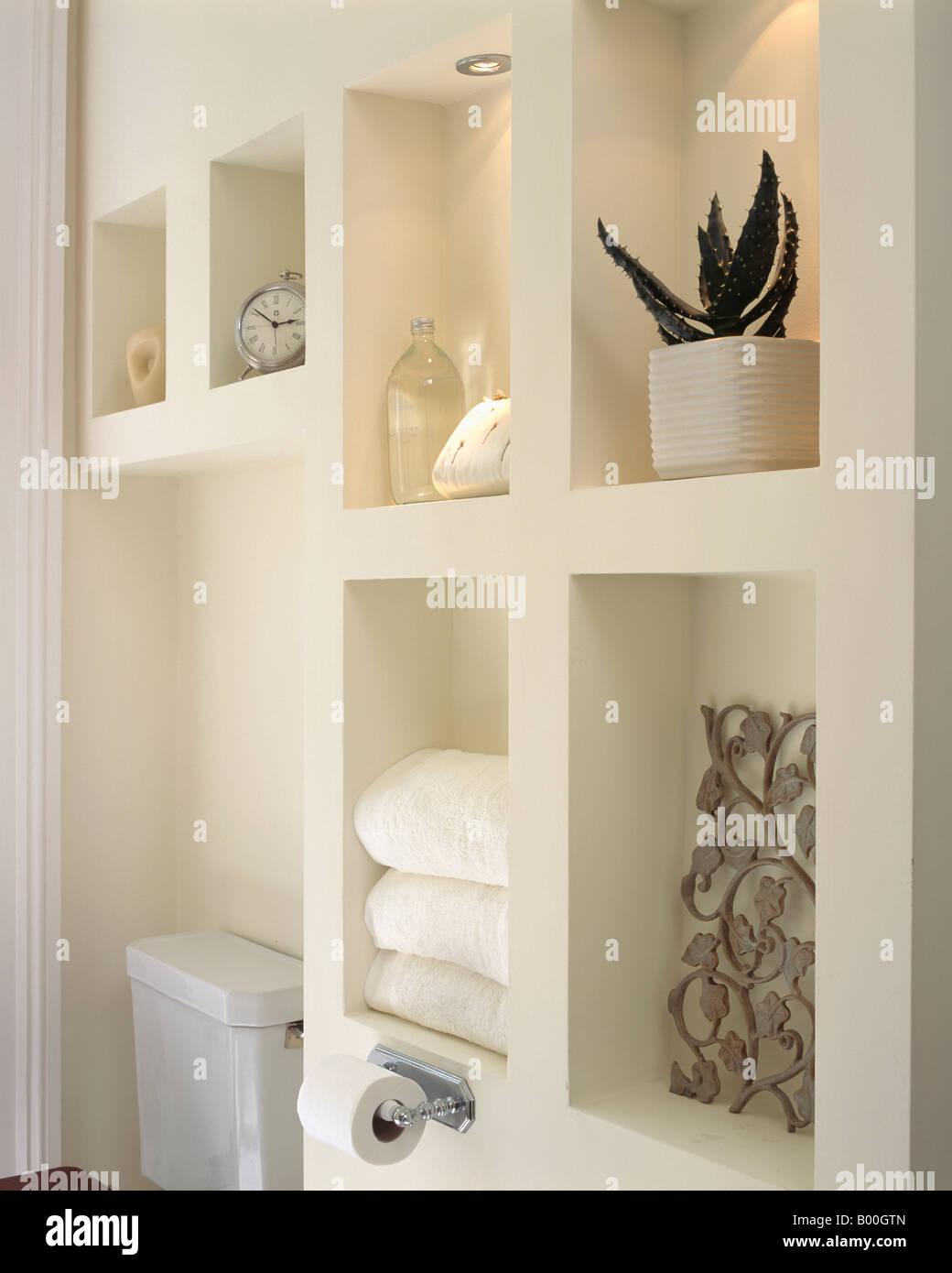 Close up of modern alcove shelving in white bathroom stock for Bathroom alcove shelves
