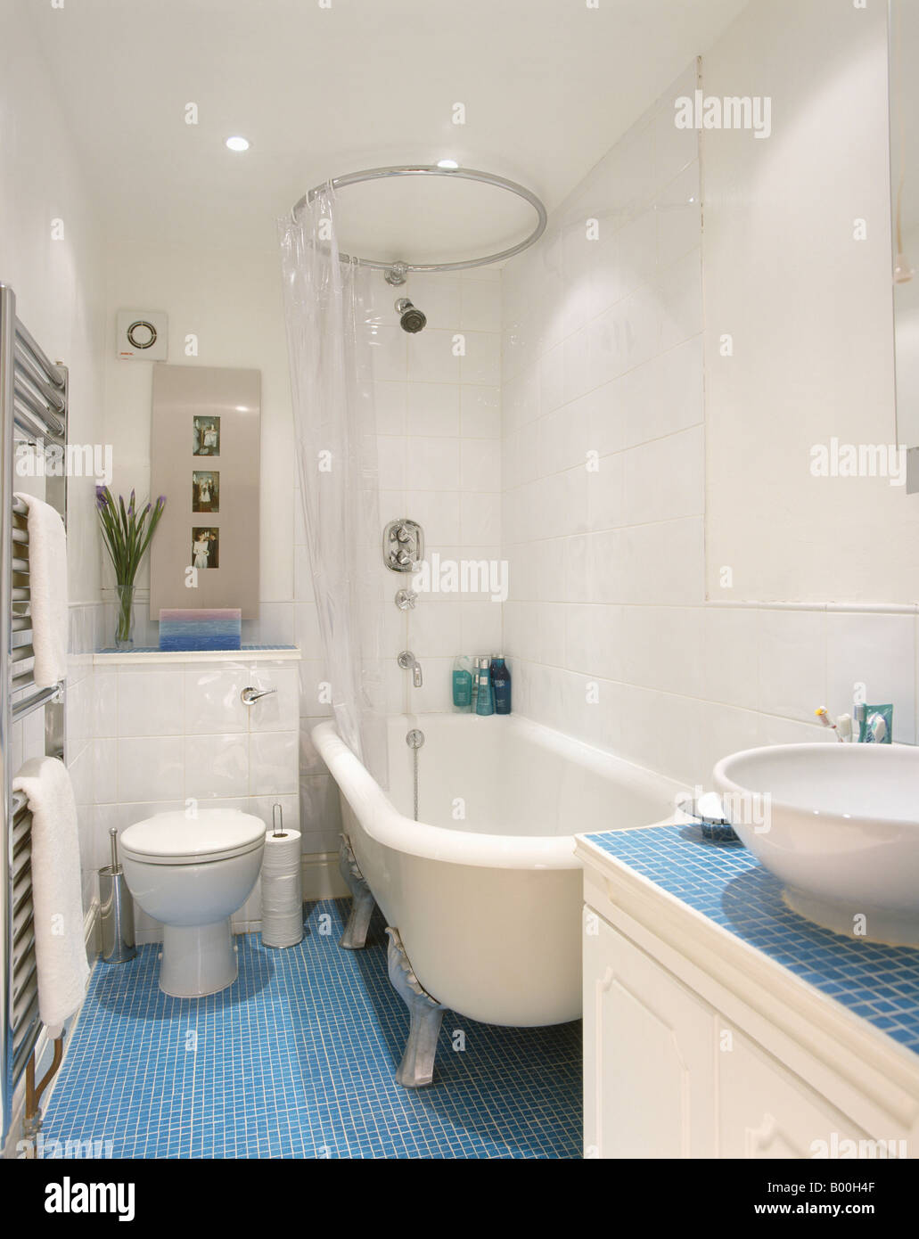 Modern blue and white bathroom - Circular Shower Rail On White Clawfoot Bath In Modern White Bathroom With Blue Mosaic Tiled Floor