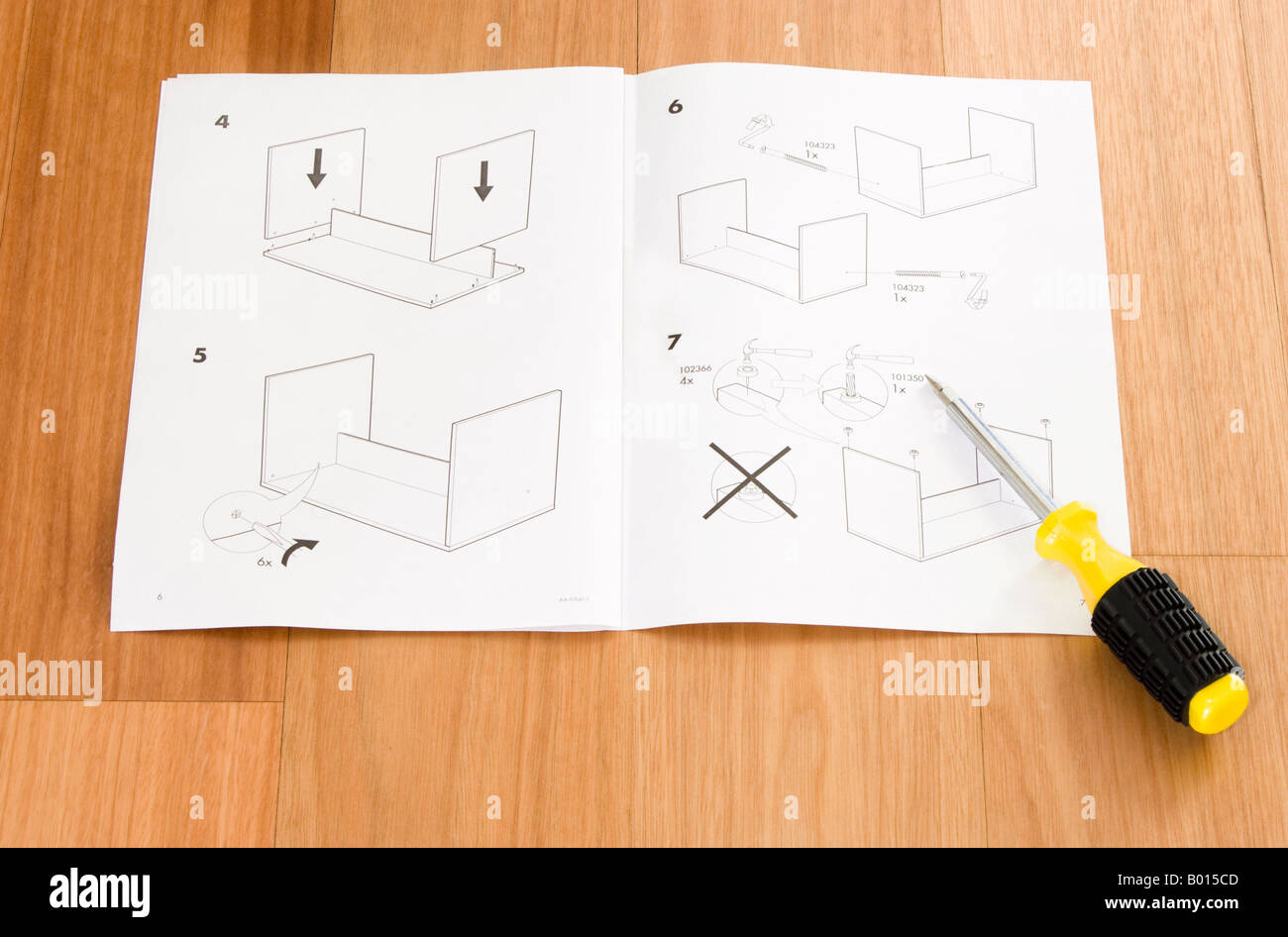 self assembly ikea furniture instructions and screwdriver stock photo royalty free image. Black Bedroom Furniture Sets. Home Design Ideas
