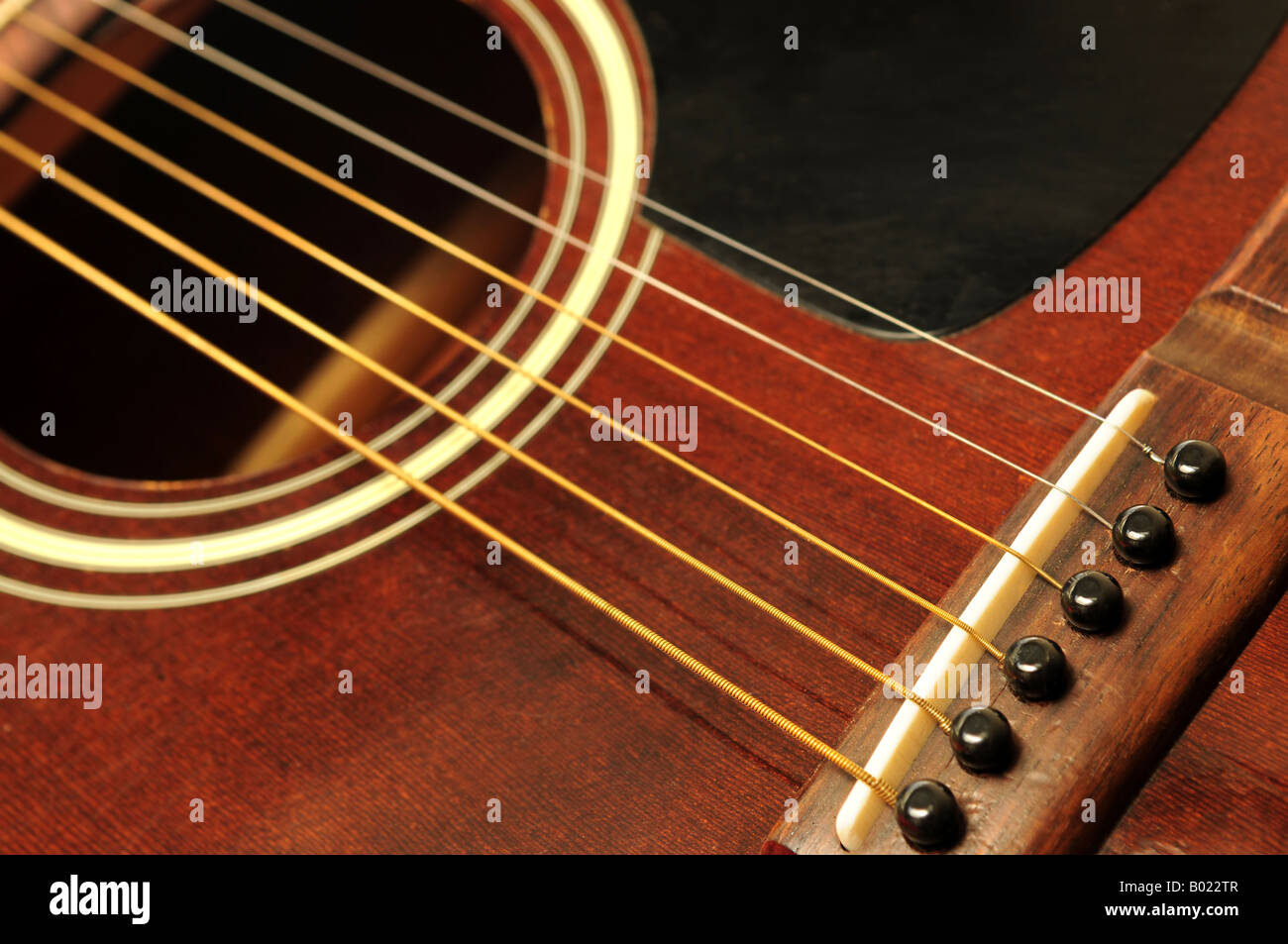 acoustic guitar bridge and strings close up stock photo royalty free image 17256535 alamy. Black Bedroom Furniture Sets. Home Design Ideas