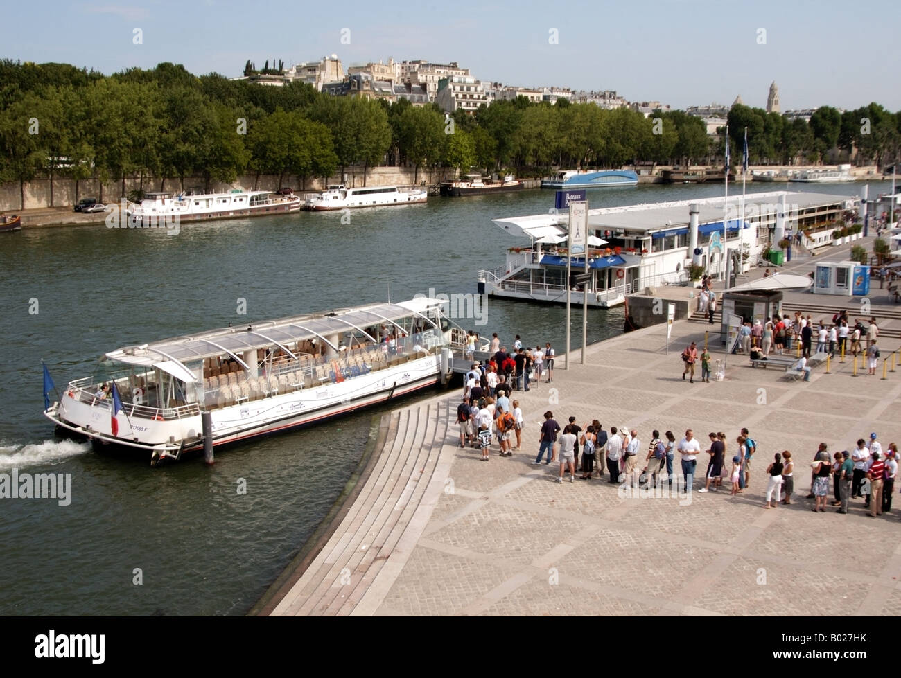 the queue for the bateaux mouches on the river seine in paris france stock photo royalty free. Black Bedroom Furniture Sets. Home Design Ideas