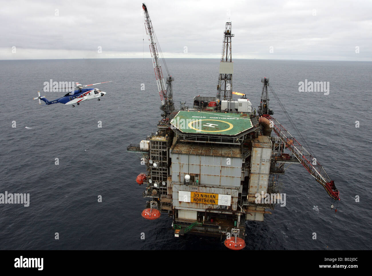 A Bristows S92 Helicopter Lands On An Oil Rig In The North Sea Off Stock Pho