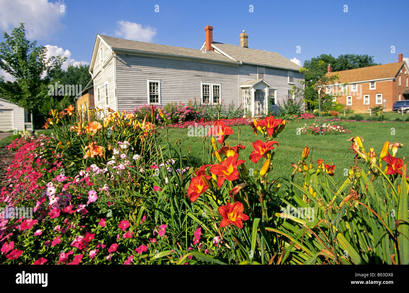 Bright Flowers In A Garden Set Off Beautiful But Old Residential Home The Amana Colonies Farm Country Of Iowa