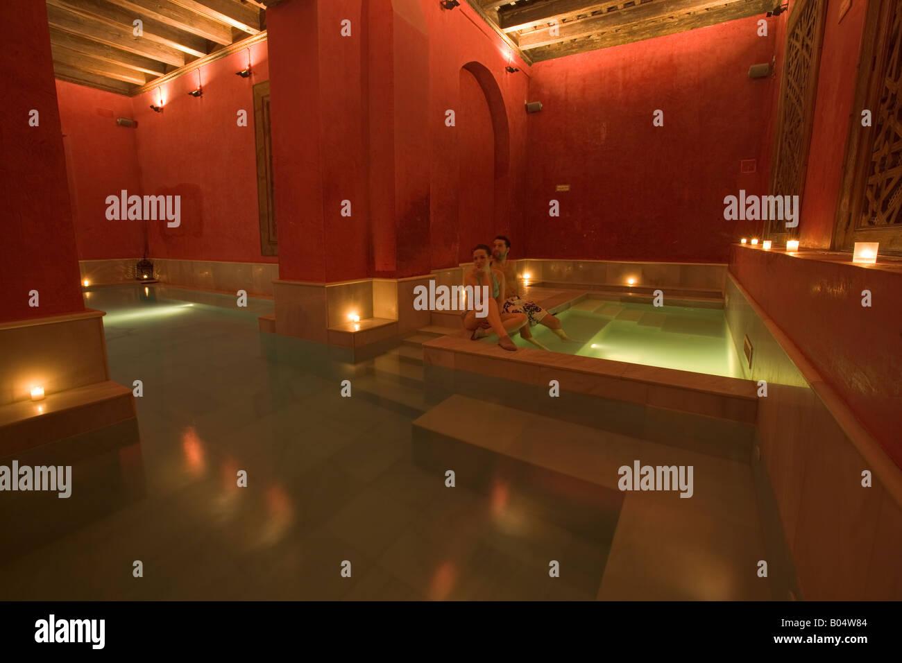 Aire De Sevilla Baños Arabes | Couple In One Of The Three Baths At Aire De Sevilla Banos Arabes