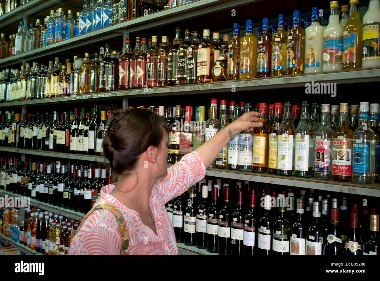 Woman shopping for alcohol in port louis market mauritius stock photo royalty free image - Mauritius market port louis ...