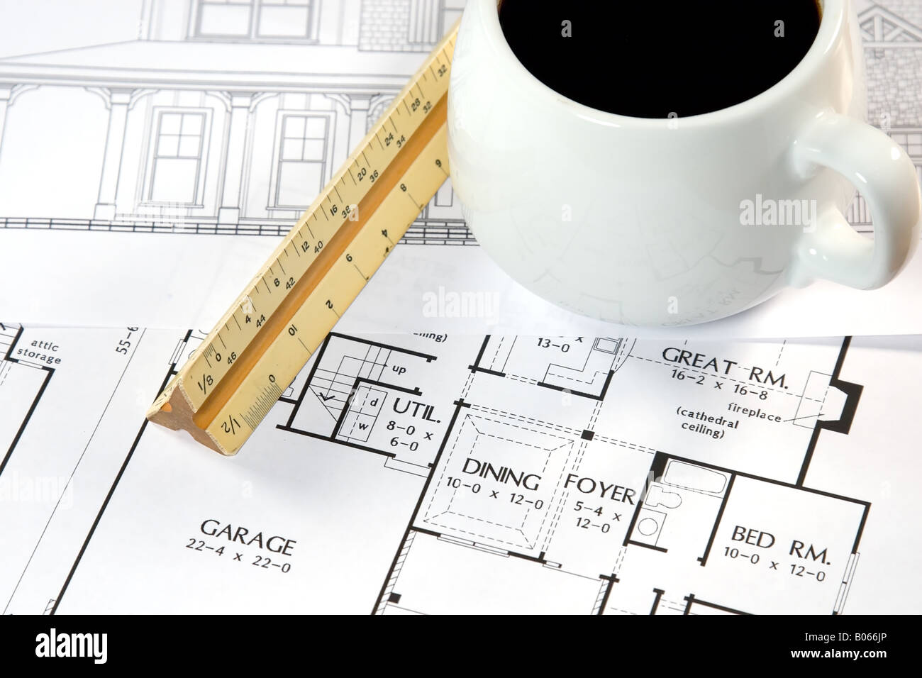 Architects Desk home design drawings and a coffee on an architects desk stock
