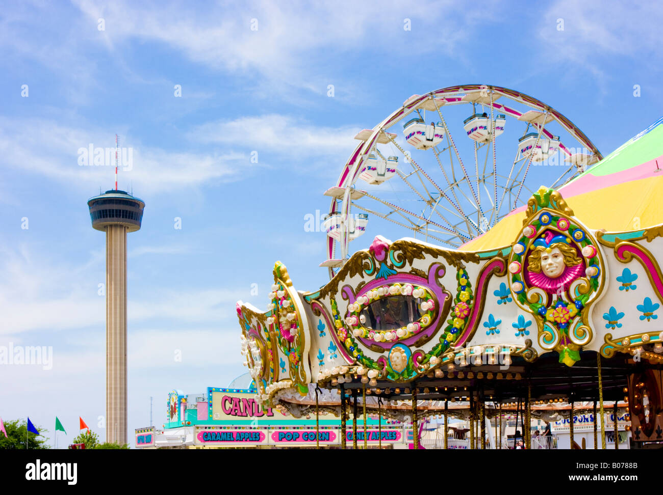 Fiesta carnival rides and tower of americas in san antonio texas stock image