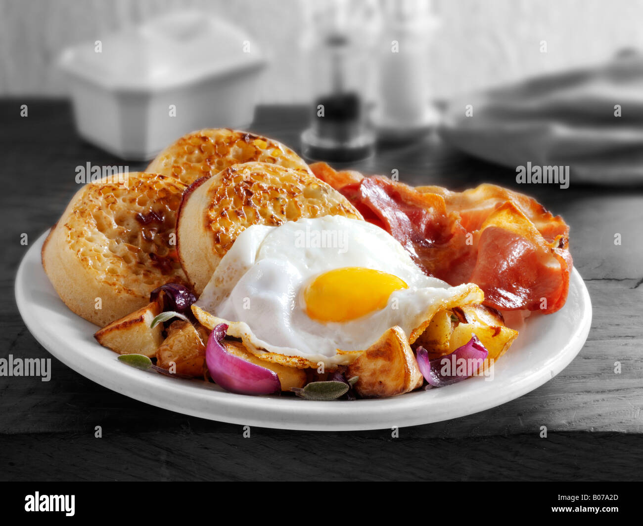 Full English Breakfast With Crumpets Sauteed Potato Onion Bacon And Fried Egg