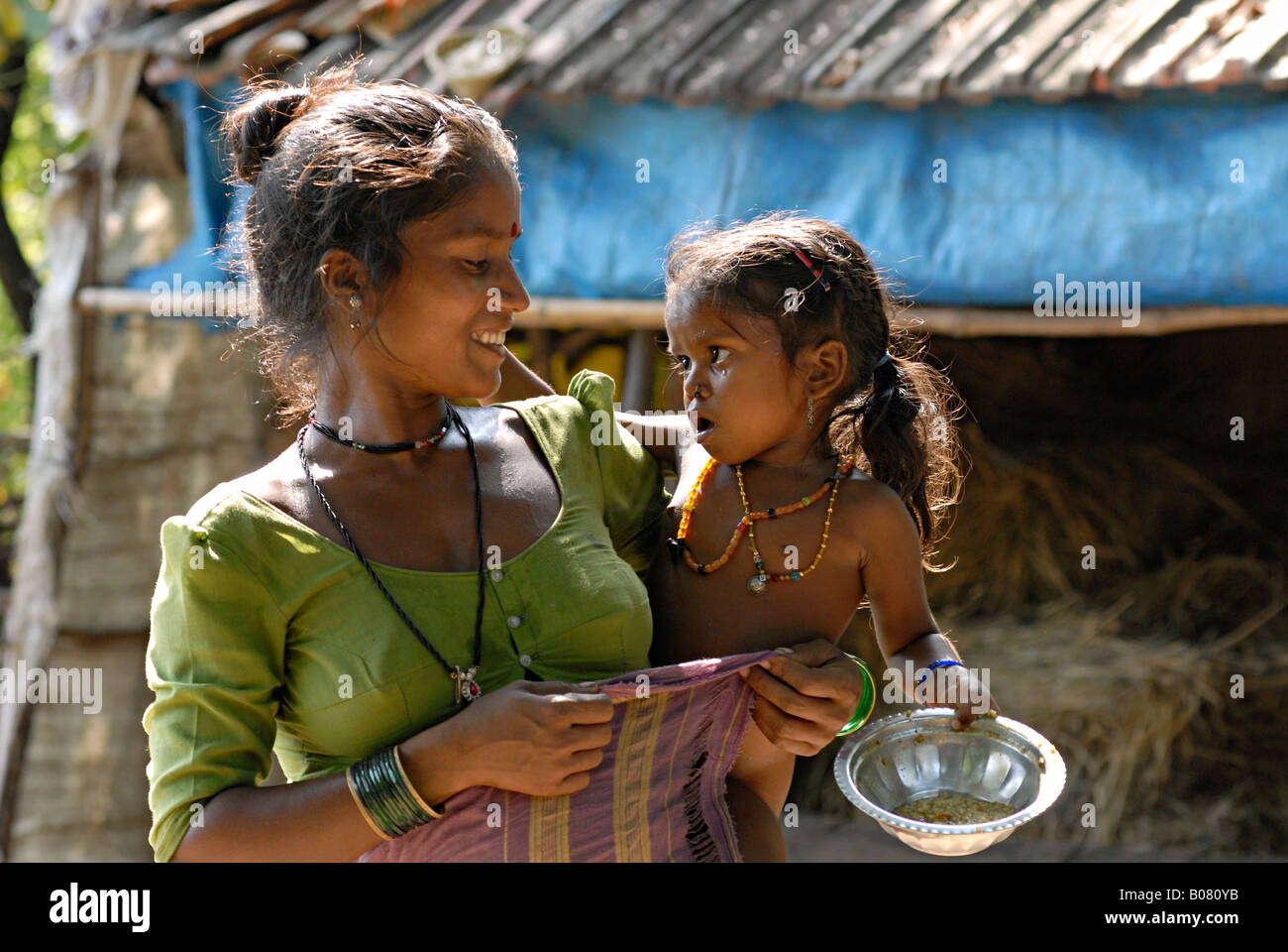 Mother with her daughter in her arms warli tribe thane stock mother with her daughter in her arms warli tribe thane maharashtra india thecheapjerseys Gallery