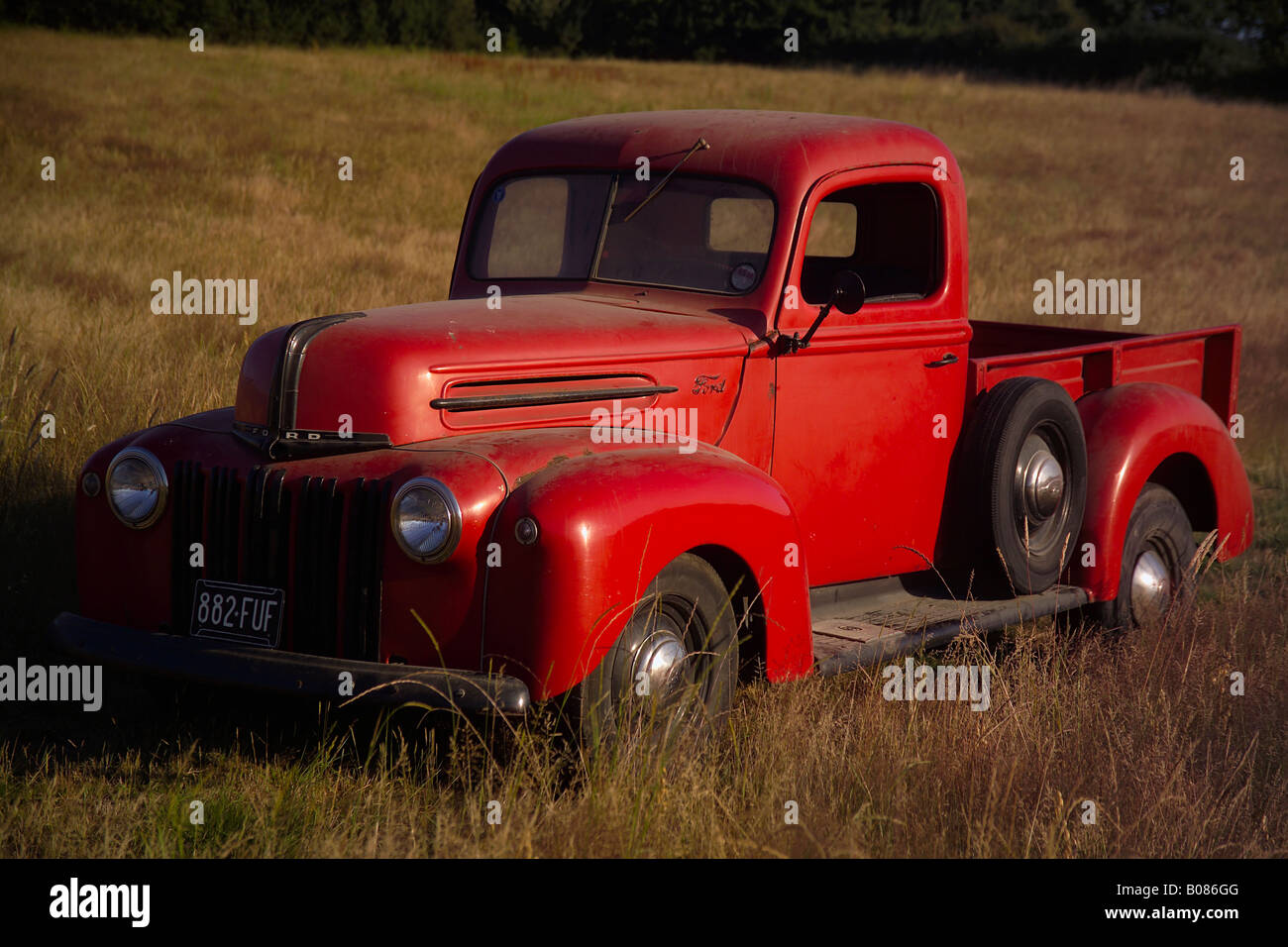 front view of an old american red ford pick up truck stock photo