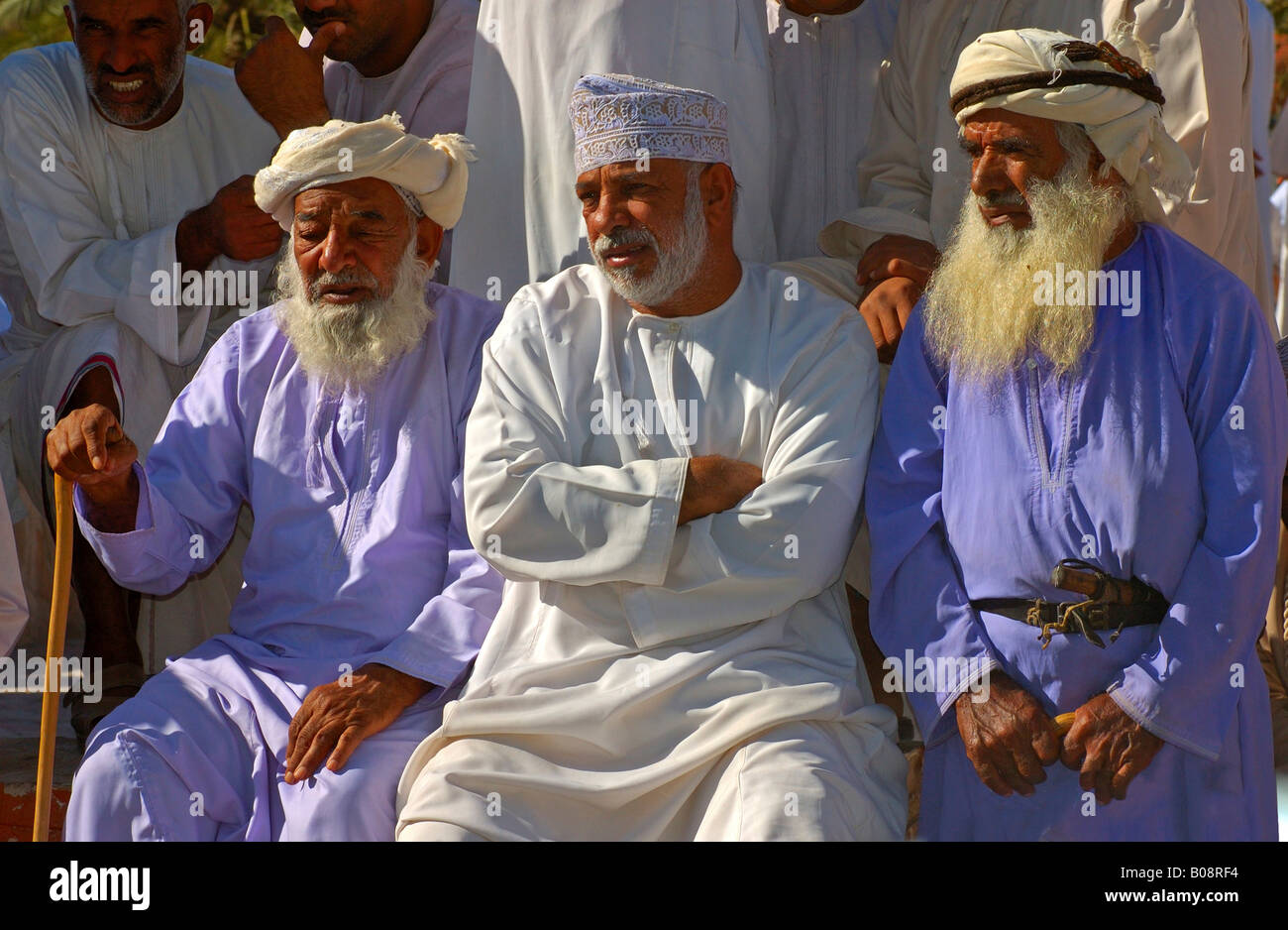 Three omani men wearing traditional dishdashi or thawb robes stock three omani men wearing traditional dishdashi or thawb robes clothing nizwa oman middle east sciox Images