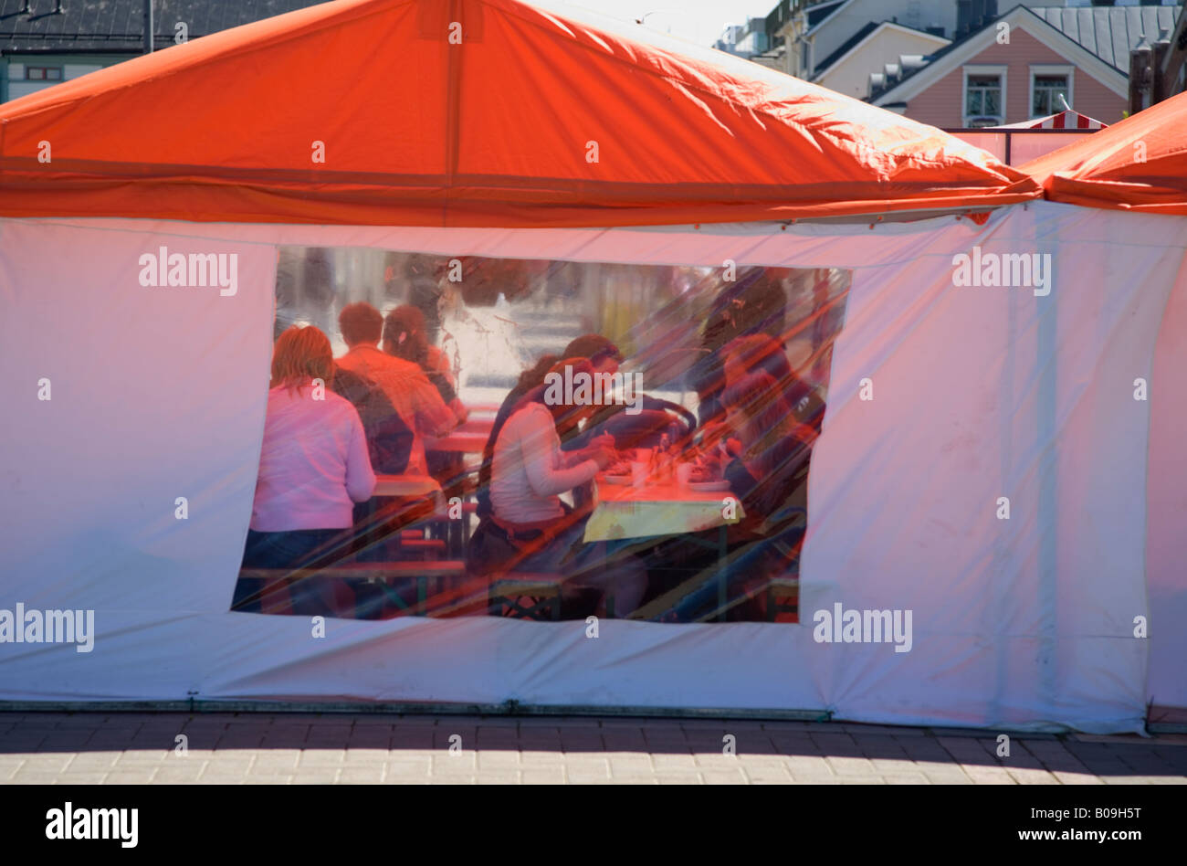 People eating inside a temporary tent restaurant  Finland & People eating inside a temporary tent restaurant  Finland Stock ...