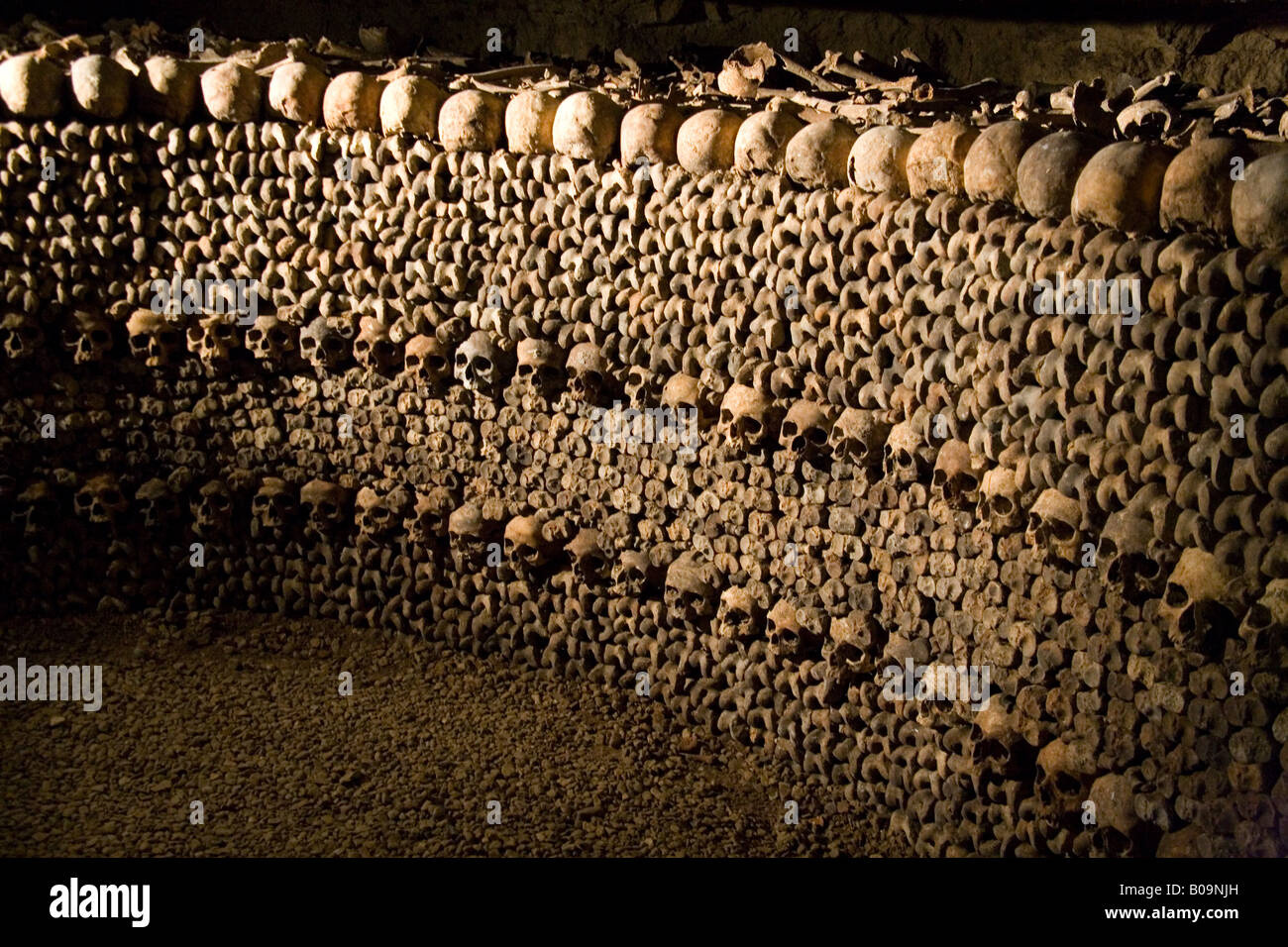 Human skulls and bones stacked in rows in the underground ...