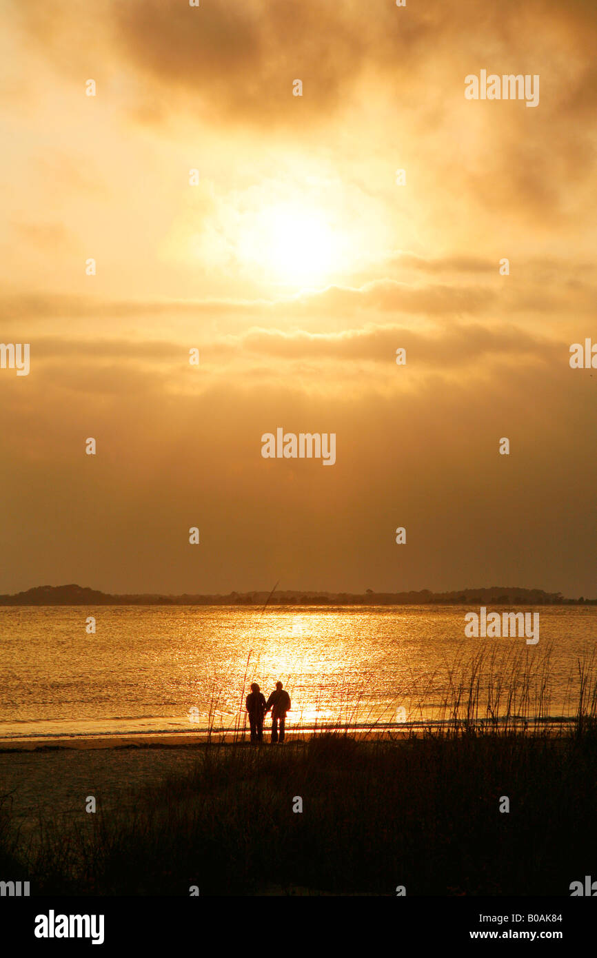Couple Walking On Beach At Sunset Edisto South Carolina Coast Near Charleston