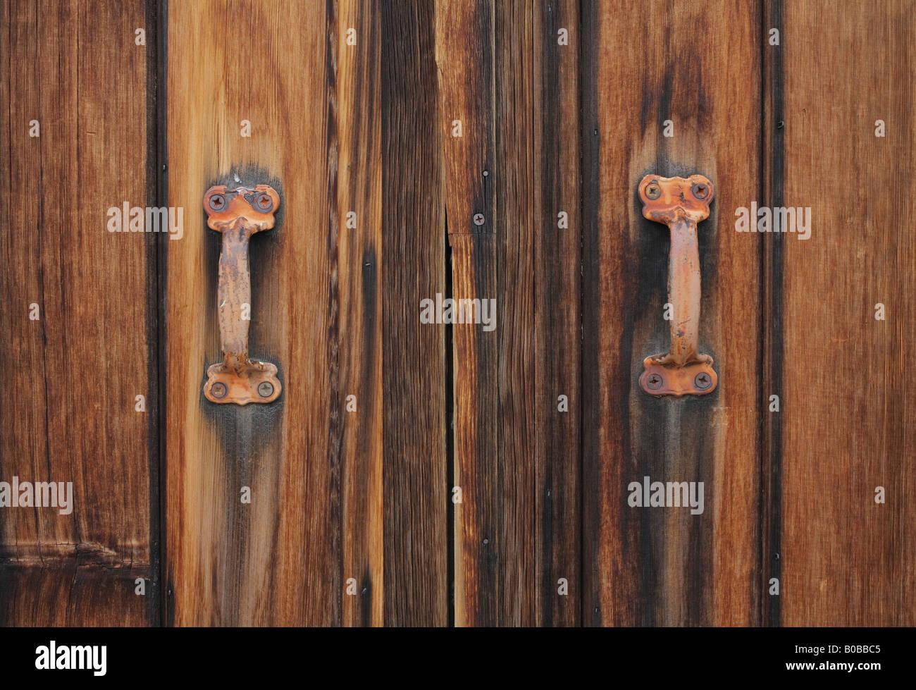 Barn door handles and locks - Old Wooden Barn Door With Rusty Handles Stock Image
