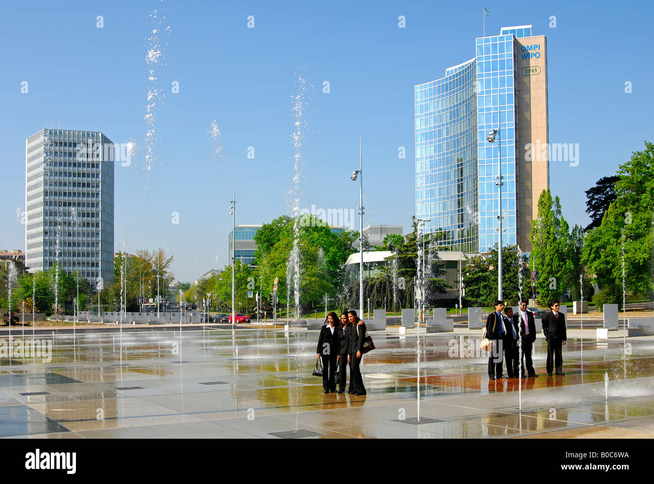 trick fountains on place des nations in geneva itu headquarters stock photo royalty free image. Black Bedroom Furniture Sets. Home Design Ideas