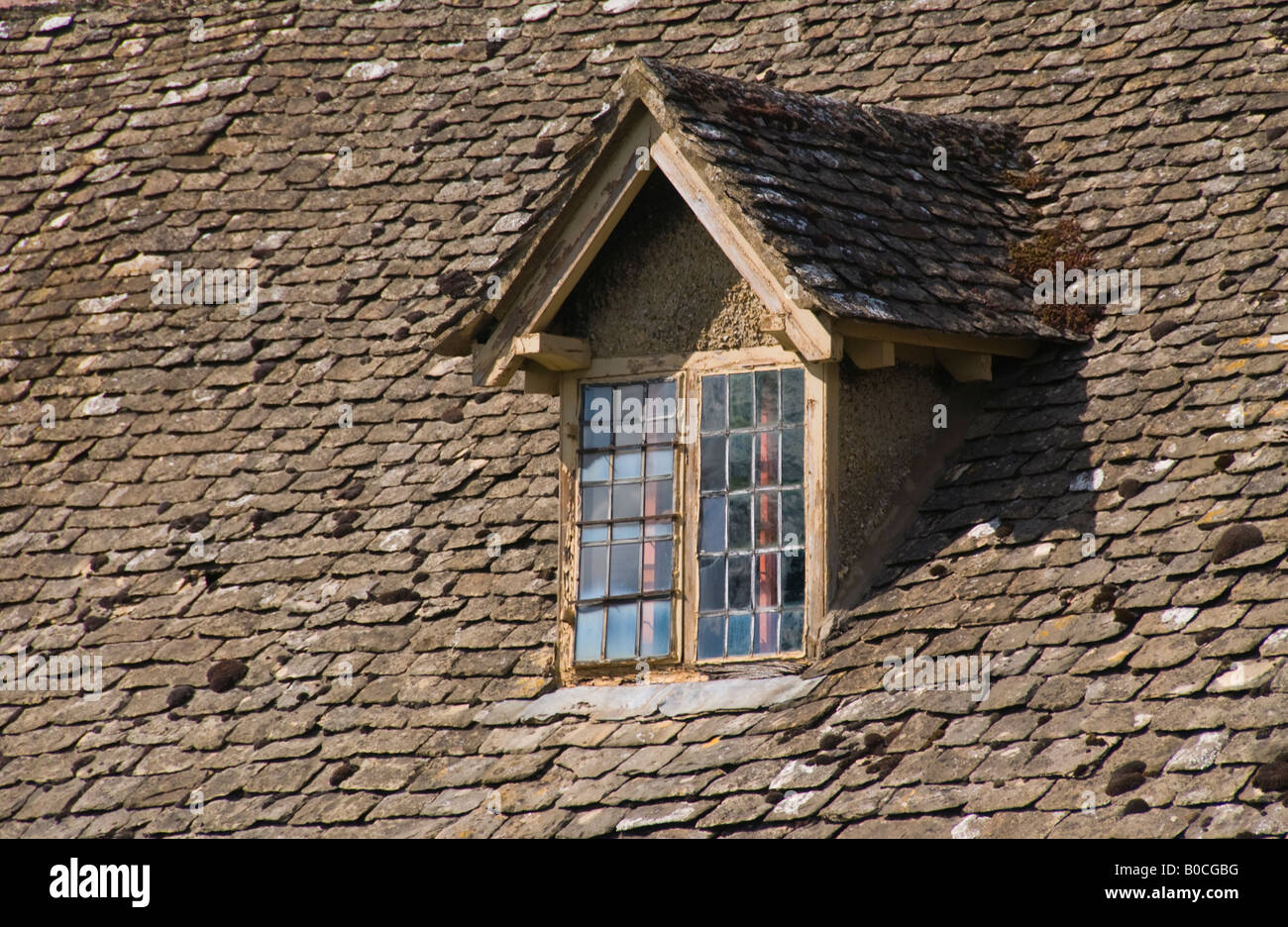 Dormer Window On Cottage With Stone Tile Roof In Village