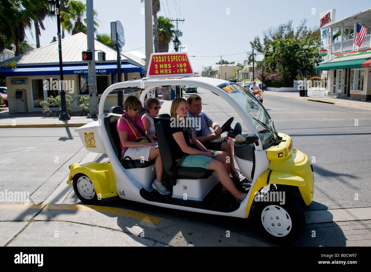 Small Electric Rental Car On The Main Street In Historic Town Of