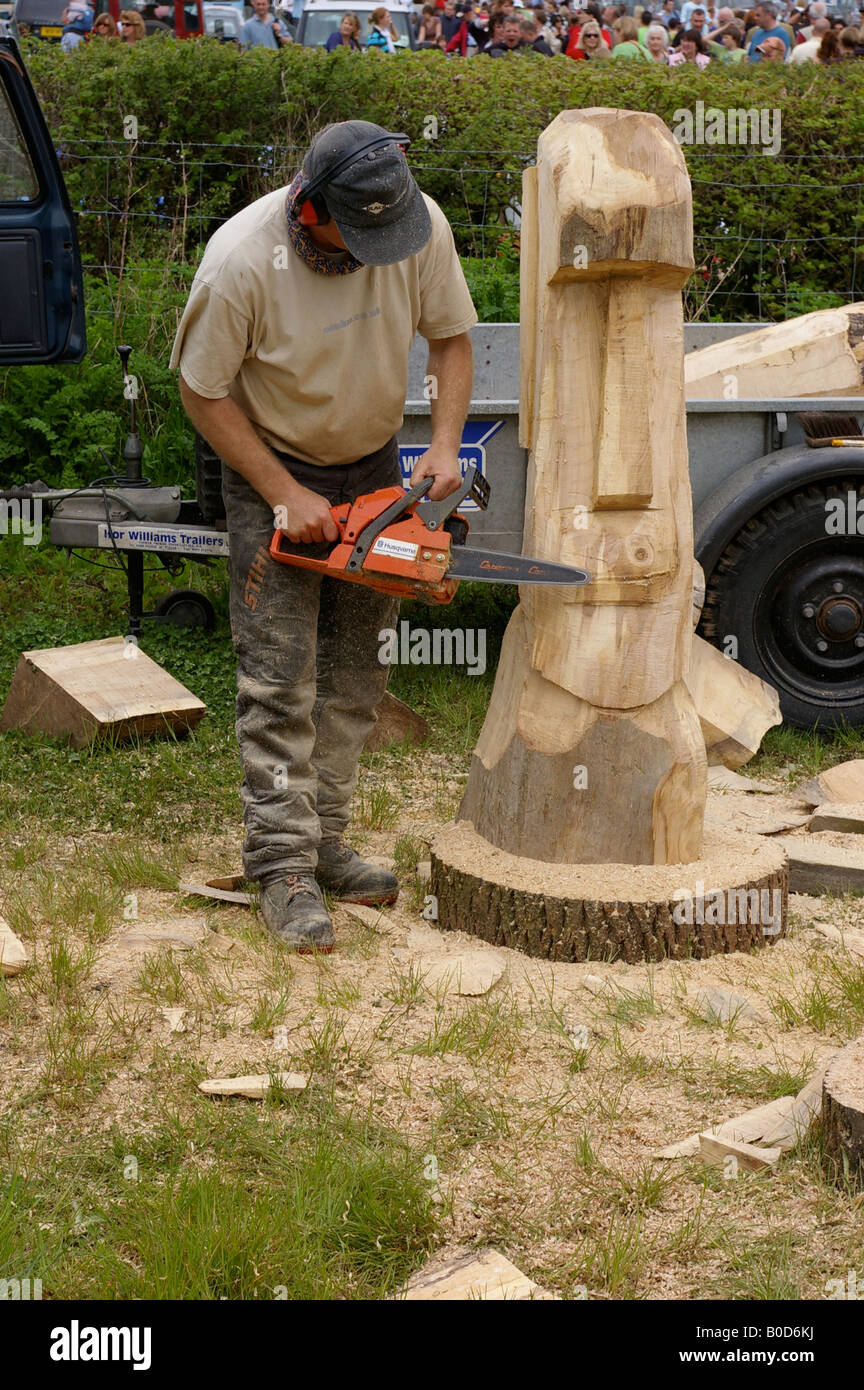 Chainsaw sculpture wood carving tribal head stock photo