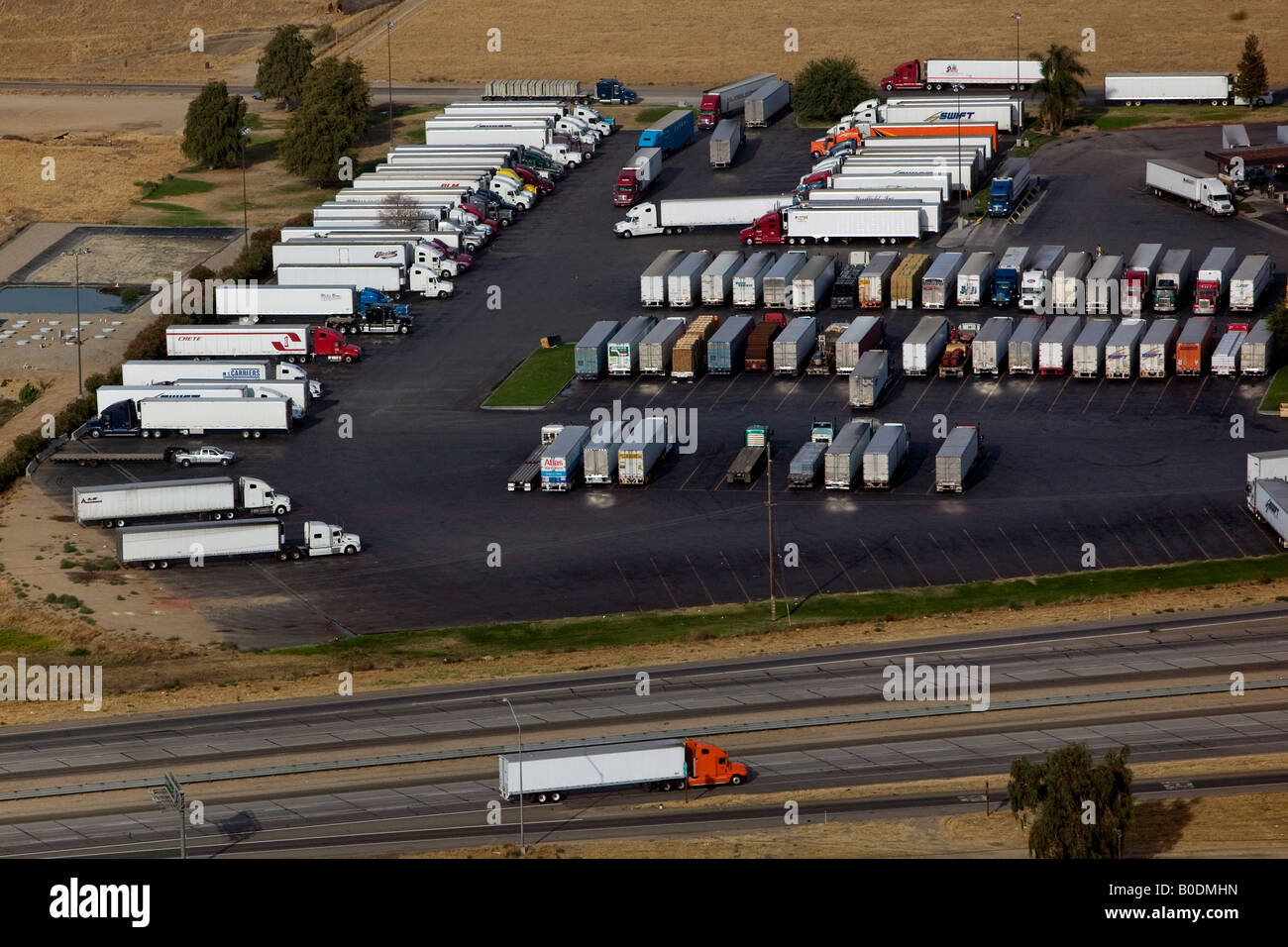Stock photo aerial above truck stop along interstate 10 in texas atlas van lines swift globe crete among the truckers stopped