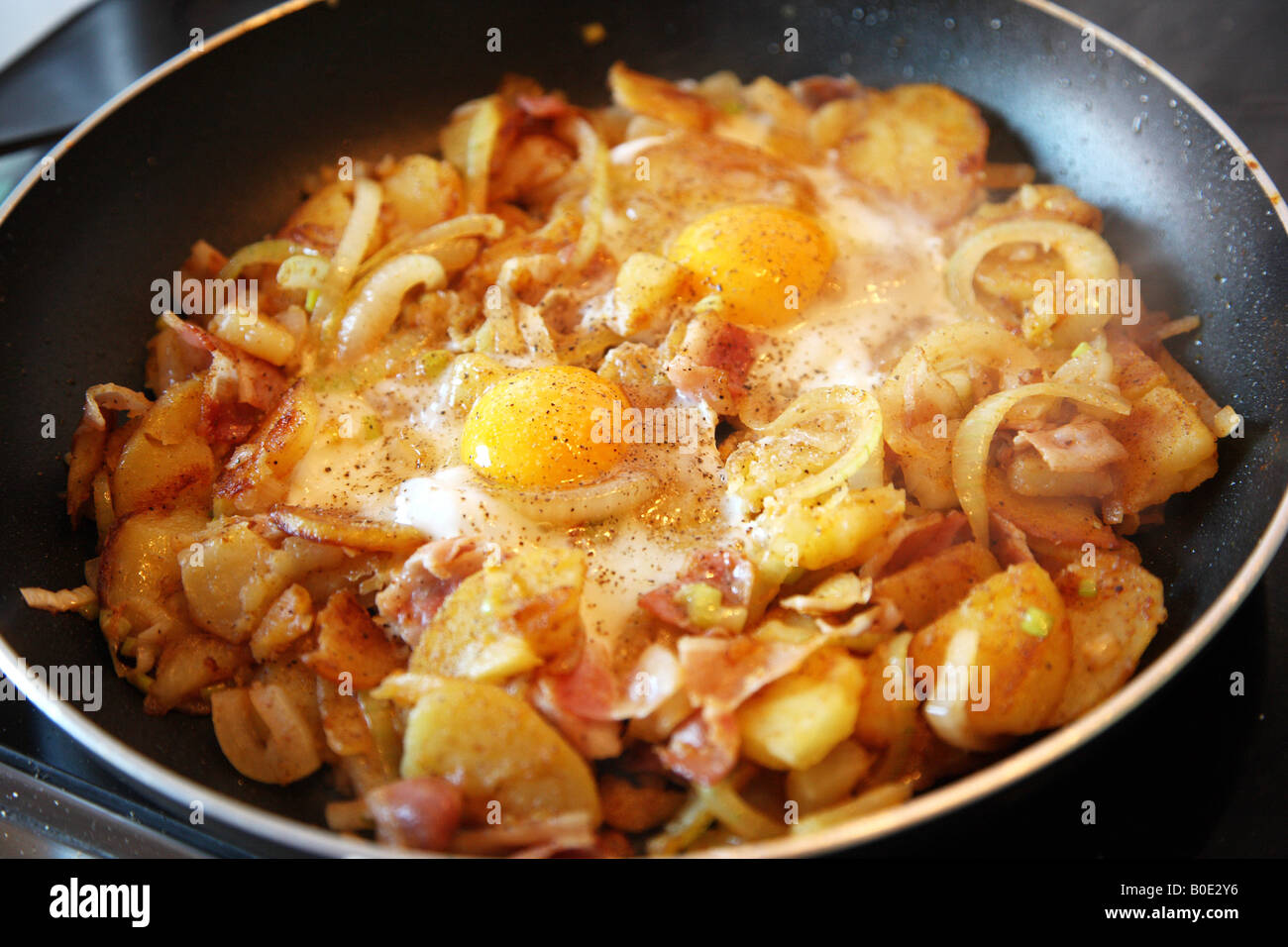 Fried Potatoes With Onions Fried Egg In A Pan