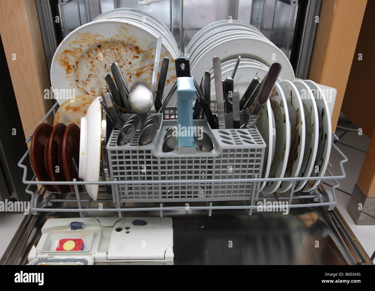DEU Germany Dirty used dishes in a dishwasher Stock Photo ...