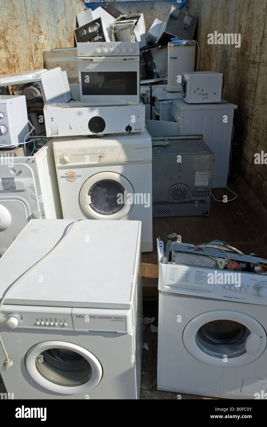 Disused kitchen appliances at a recycling centre, Oldenburg, Lower ...