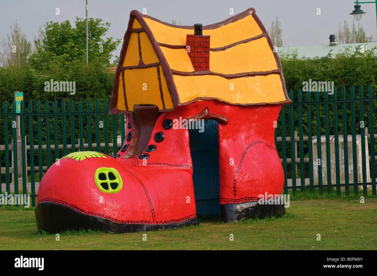 Large Red Shoe / Boot Child's Play House Stock Photo, Royalty Free ...