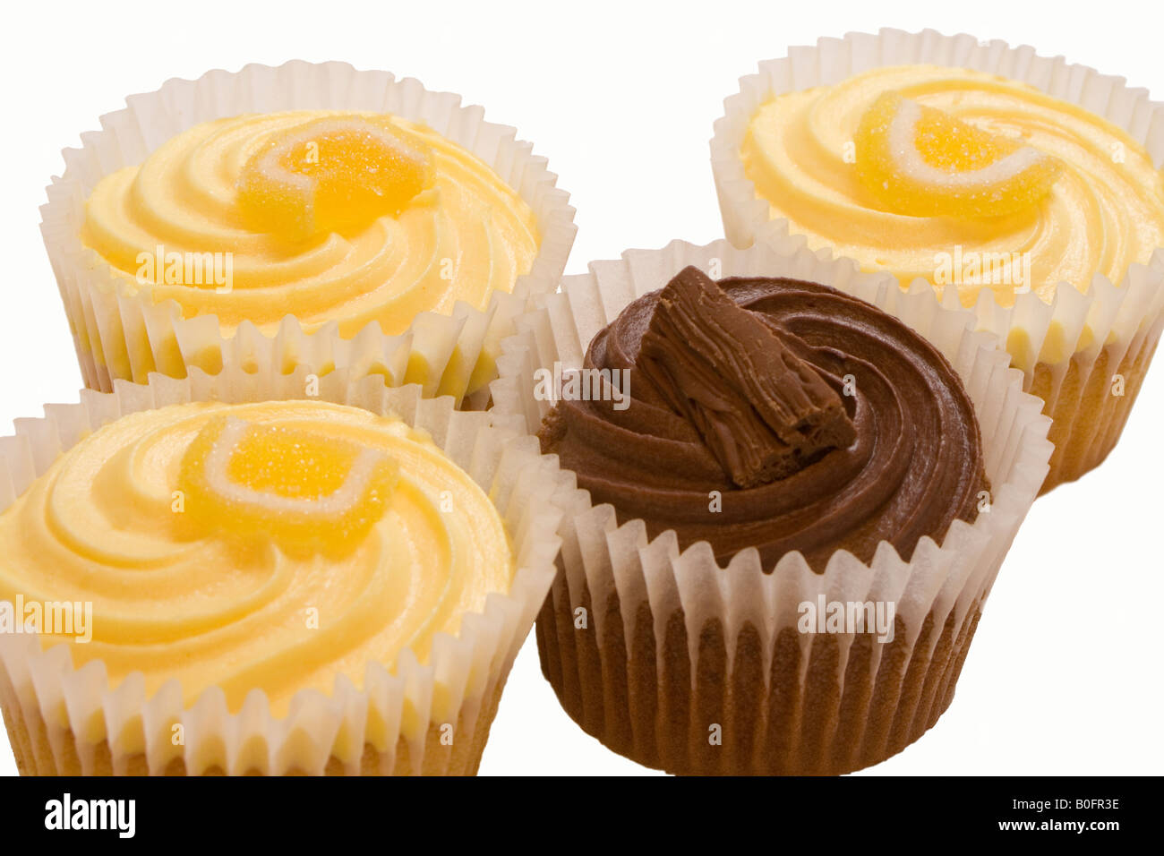 Lemon Buns With Butter Icing And Sugared Lemon And A Chocolate Bun Topped With A Flake