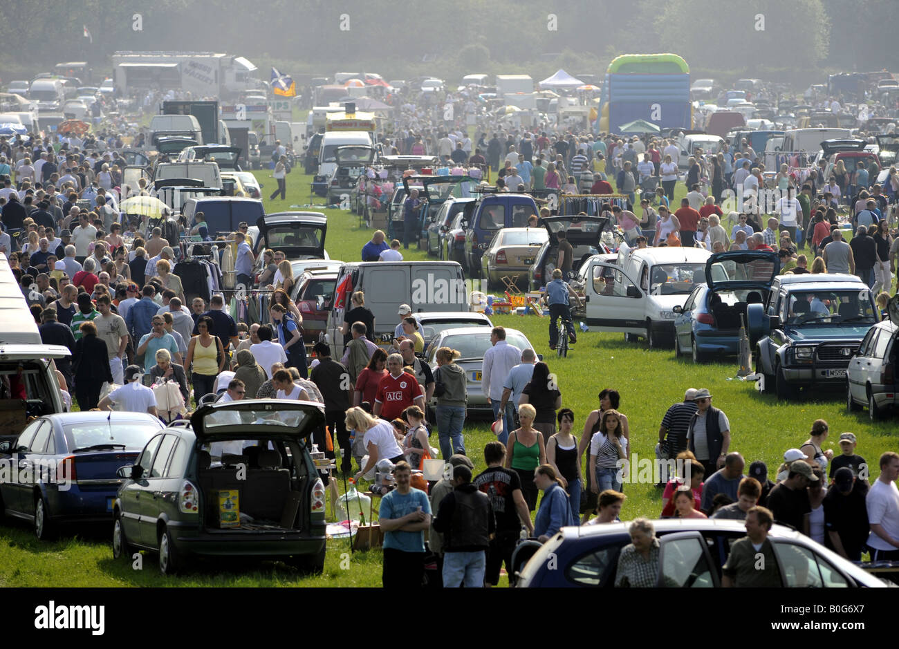Crowds at a car boot sale in staffordshire re sunday markets bargain hunters grey selling second