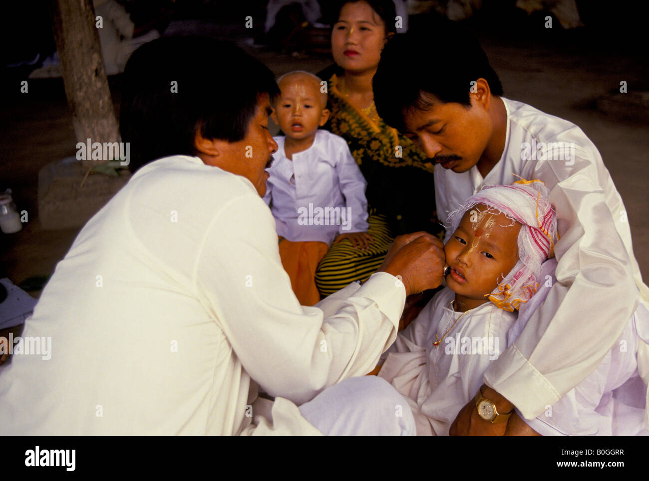 An earpiercing ceremony for the Pre-Hindu rite of passage, in a ...