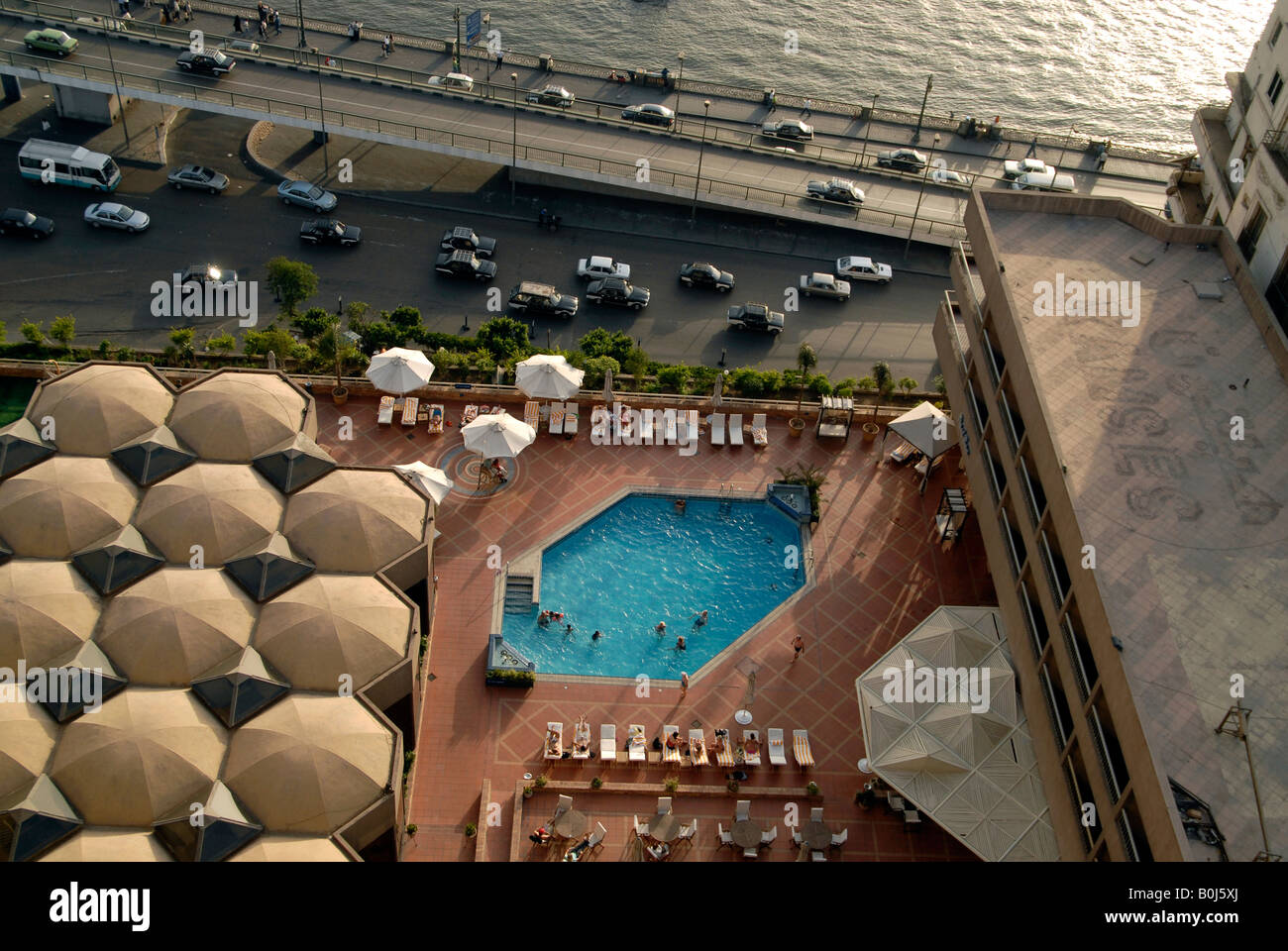 Tourists in the ramses hilton swimming pool by the river - Hilton swimming pool ...