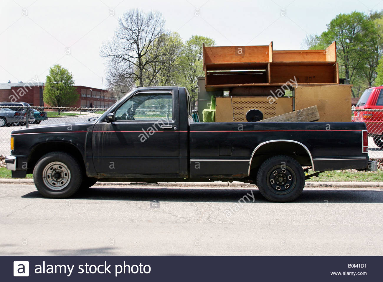 furniture moving out moving carry truck pick up Stock