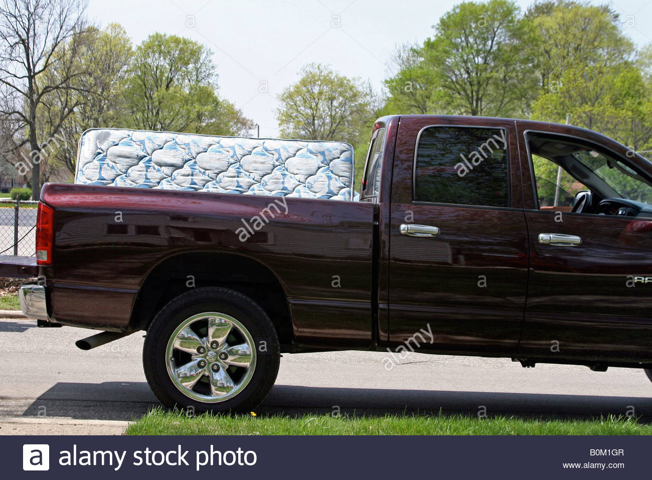 furniture moving out mattress moving carry truck pick up stock photo royalty free image. Black Bedroom Furniture Sets. Home Design Ideas