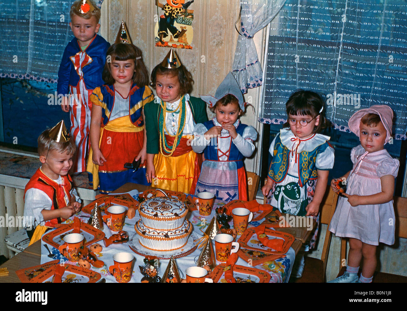 Children and a table set for a Halloween party, USA, 1950s Stock ...